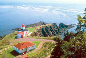 A lighthouse overlooks Cape d'Or, near Advocate Harbour, NS (courtesy Corel Professional Photos).