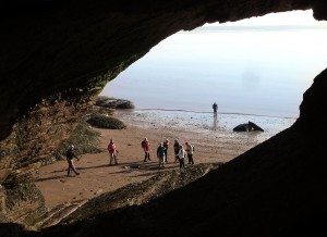 Looking out from inside a huge sea cave at the Hopewell Rocks
