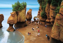 People walking on the ocean floor at Hopewell Rocks in New Brunswick [Photo: New Brunswick Tourism and Parks]
